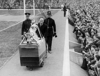 Arsenal Manager George Allison Parading Trophies at Highbury