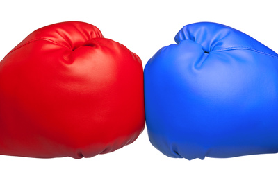Red and Blue Boxing Gloves Clashing