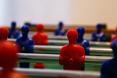 Table Football with Red and Blue Players